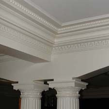 decorative capitals with surrounding millwork