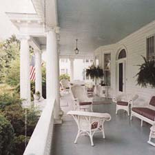 back porch columns with decorative capitals