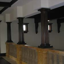 fluted interior decorative columns on top of a balustrade railing