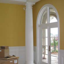 fluted decorative columns with a wainscot system